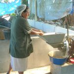 a woman is grinding nuts.